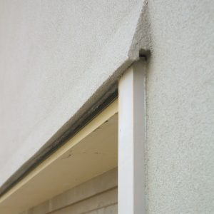 Eyebrow over a garage door to deflect rainwater