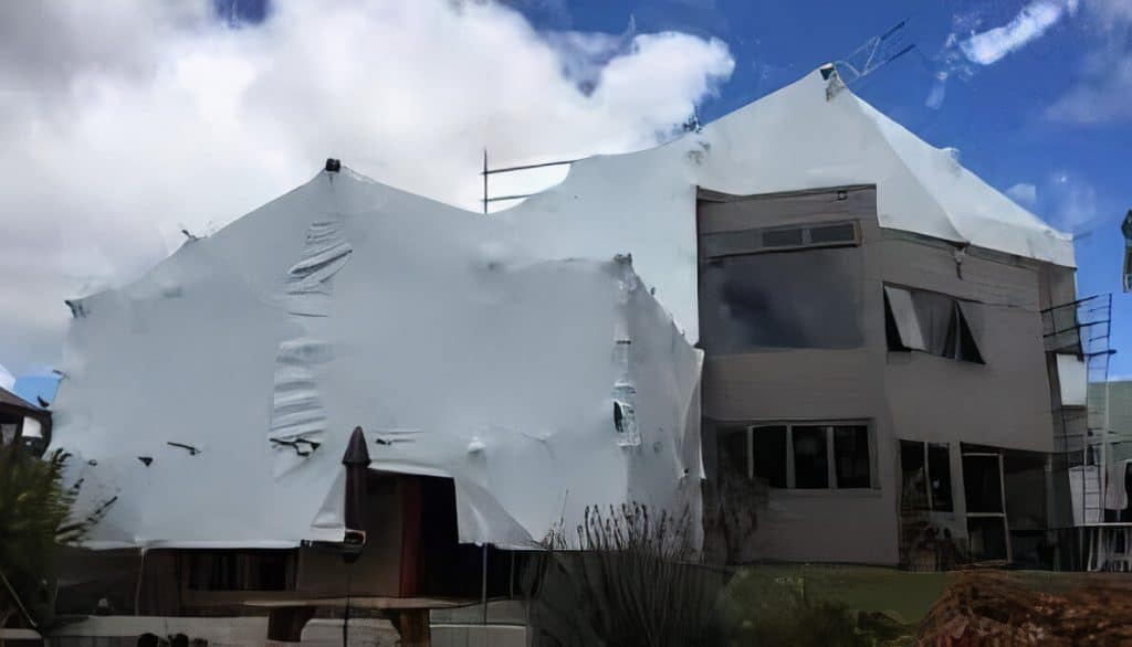 plaster home being re-clad